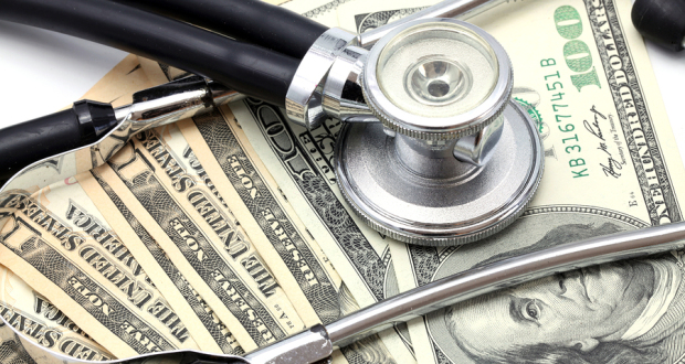 bigstock-Stethoscope-on-Money-Dollar-Ca-28818041
