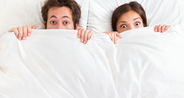 bigstock-Funny-couple-in-bed-looking-an-31765238
