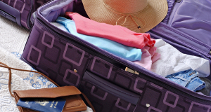 bigstock-Modern-luggage-partially-packe-15024971