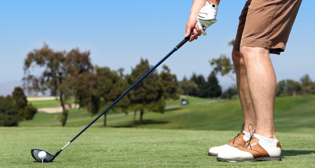 bigstock-Man-playing-a-game-of-golf-out-51442462
